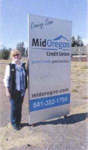 La Pine Chamber's Ann Gawith with the Mid Oregon sign